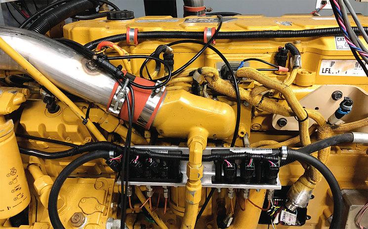 Блок ICA от HyTech Power с датчиками, интерфейсом и трубками подачи водорода, установленный на дизеле